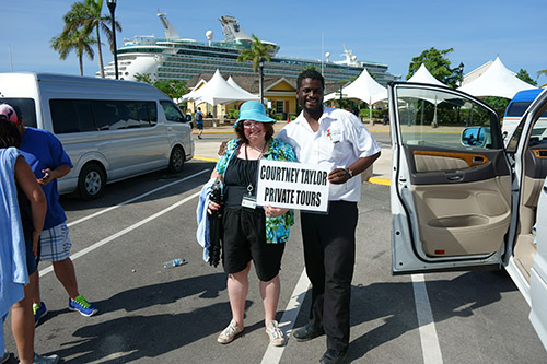 Courtney Taylor with Courtney Taylor Tours poses with Q in front of our cruise ship. Courtney Taylor Tours is  a private excursion company at the Jamaica port for Royal Caribbean's Navigator of the Seas on our Caribbean Cruise vacation