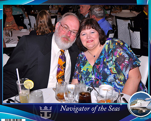 Us at the first formal dinner night in the Sapphire Room, the Main Dining Room on Royal Caribbean's Navigator of the Seas on our Caribbean Cruise vacation